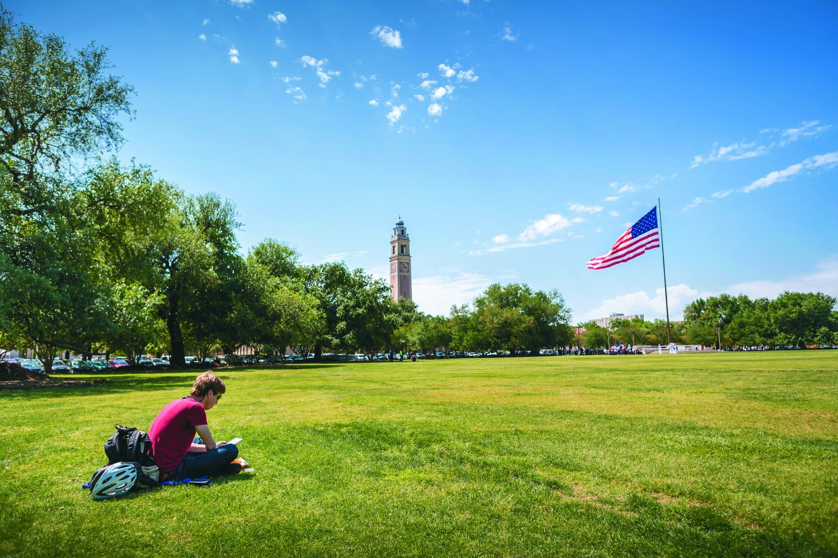 Student reading on the parade grounds